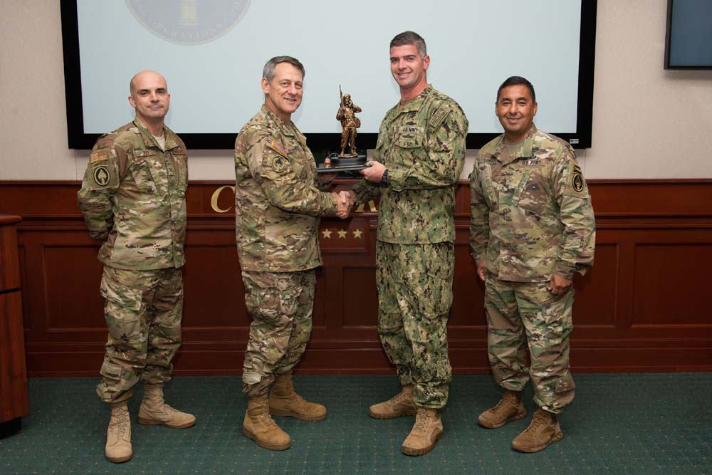 half off db40d eb47c Army Maj. Gen. James Linder, U.S. Special Operations Command chief of  staff, presents a 2018 Special Operations Forces Communicator of the Year  award to ...