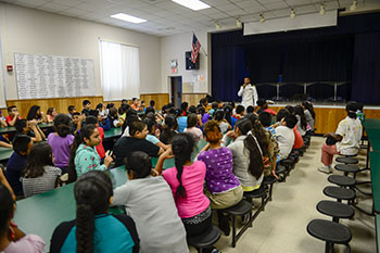 Retired Lt. Cmdr. Evangelo Morris had what some may consider a challenging task: teach 100 elementary school students the signif