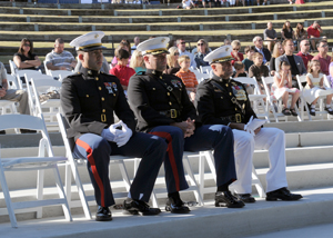 Maj. Gen. Mark Clark sits with MARSOC Marines during a 9/11 ceremony.