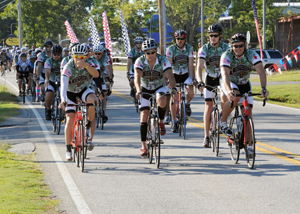Maj. Gen. Mark Clark rides with Operations One Voice cyclists.