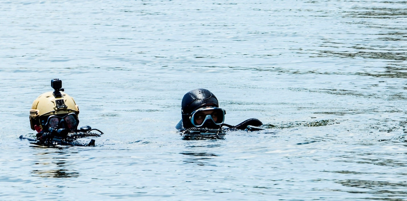 Two Navy SEALs surface before boarding a cruise ship in Tampa